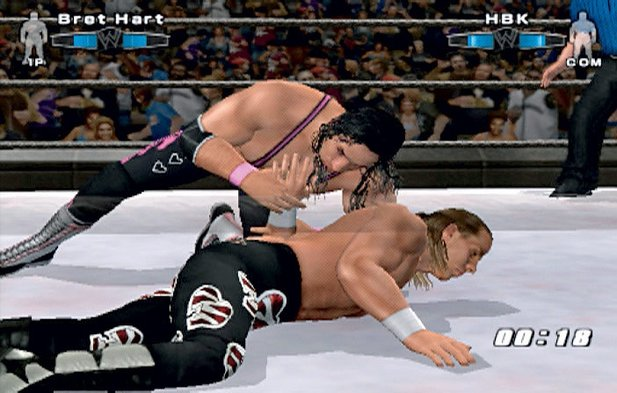 Rache für den Betrug bei der Survivor Series 1997: WWE-Legende Bret »Hitman« Hart kämpft den »Heartbreak Kid« Shawn Michaels unnachgiebig zu Boden. Screen: PS2